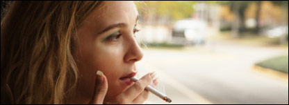 a young woman smoking